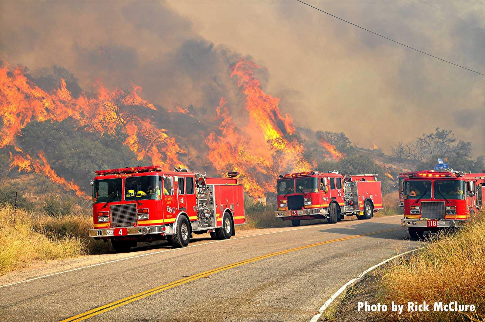 Fire trucks near wildland fire in California