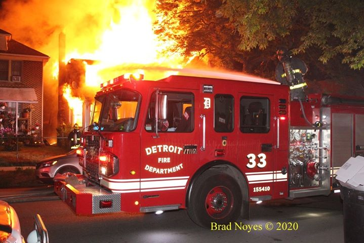 Detroit fire truck with flames behind it