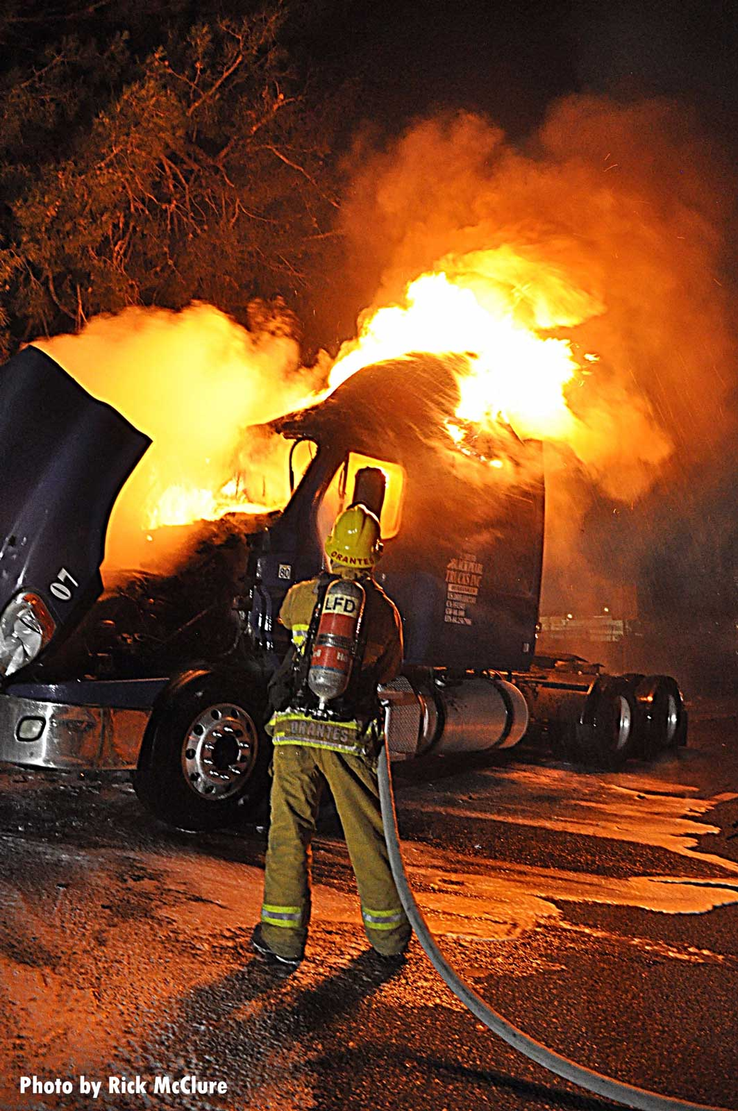 A firefighter works a tractor trailer fire in Los Angeles