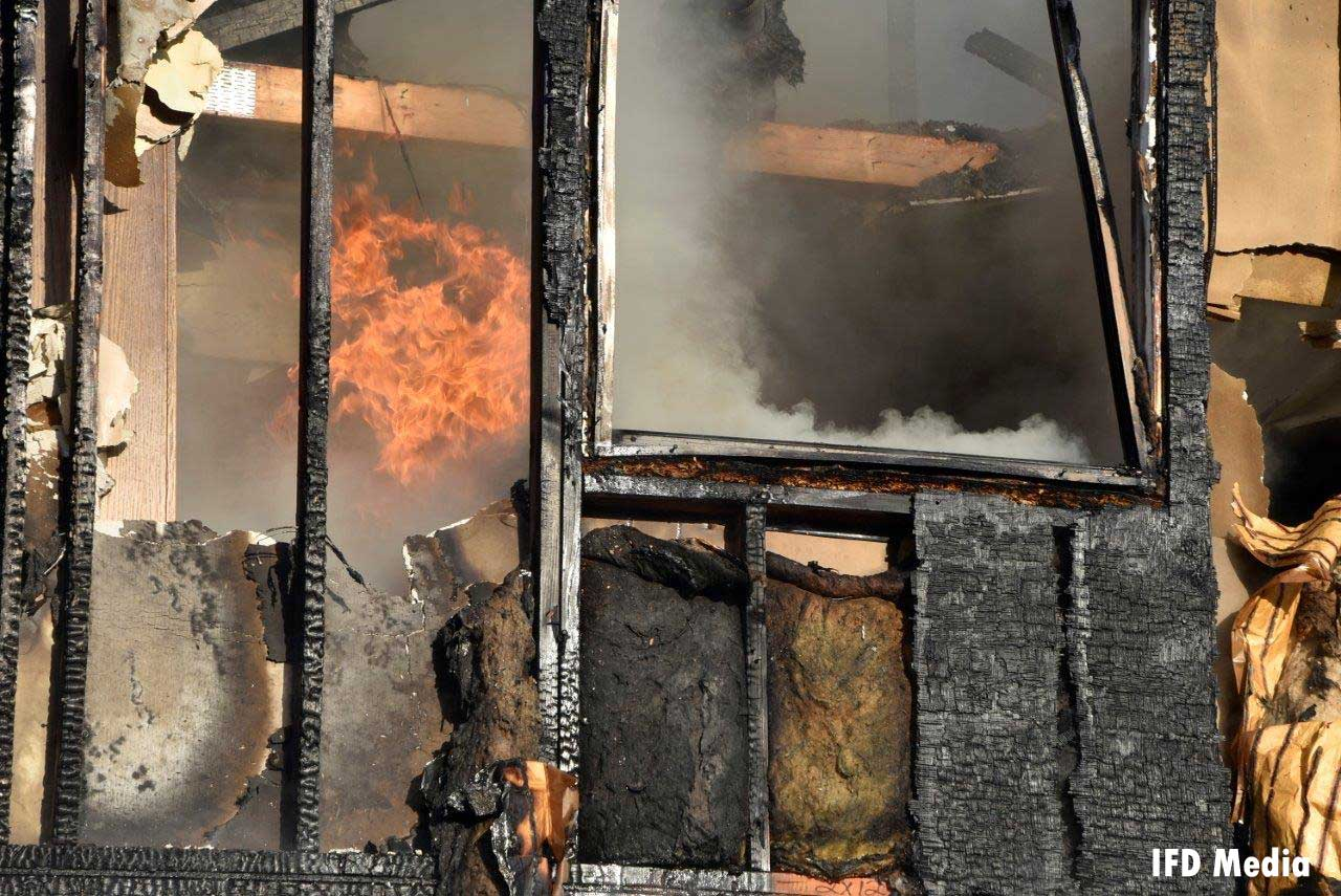 Flames inside the burned-out structure