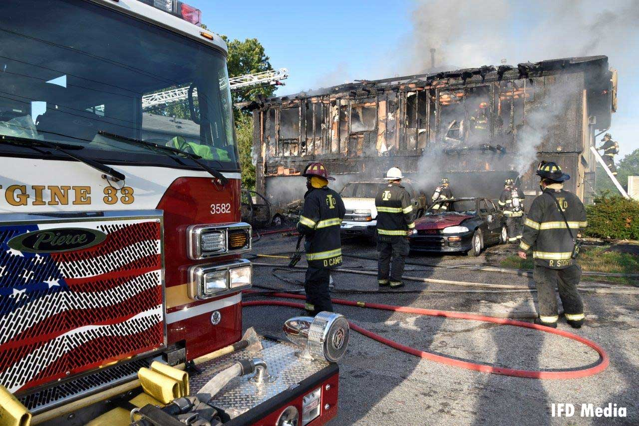 Fire trucks and firefighters at the scene of the deadly fire in Indiana
