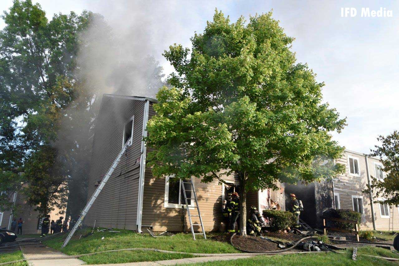 Ground ladders and smoke condition at apartment fire