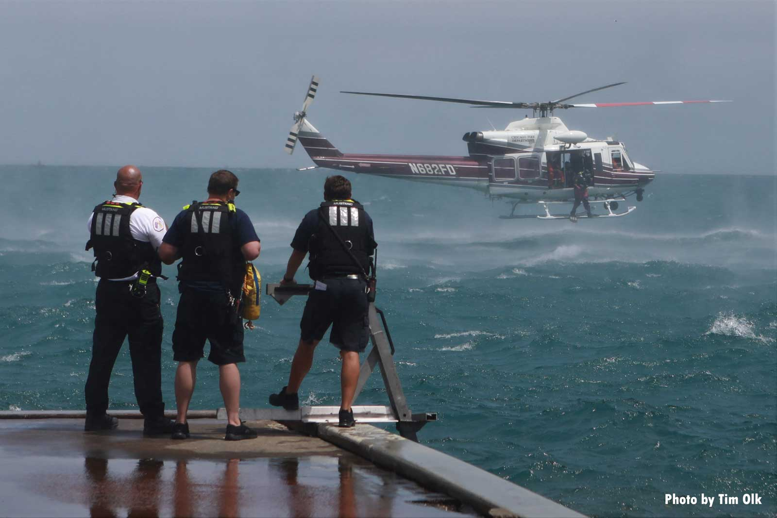 Chicago fire officials with helicopter in background