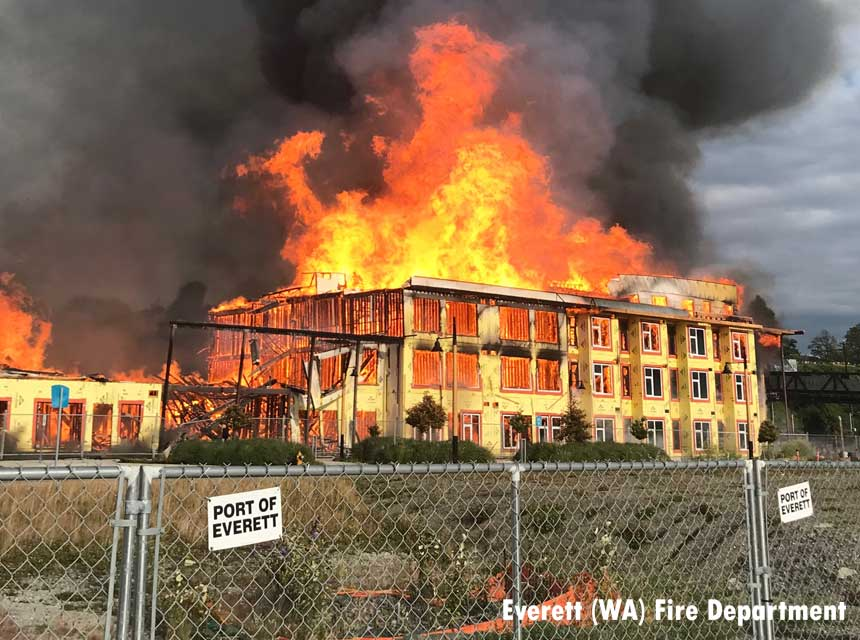 Flames rage through apartment fire under construction