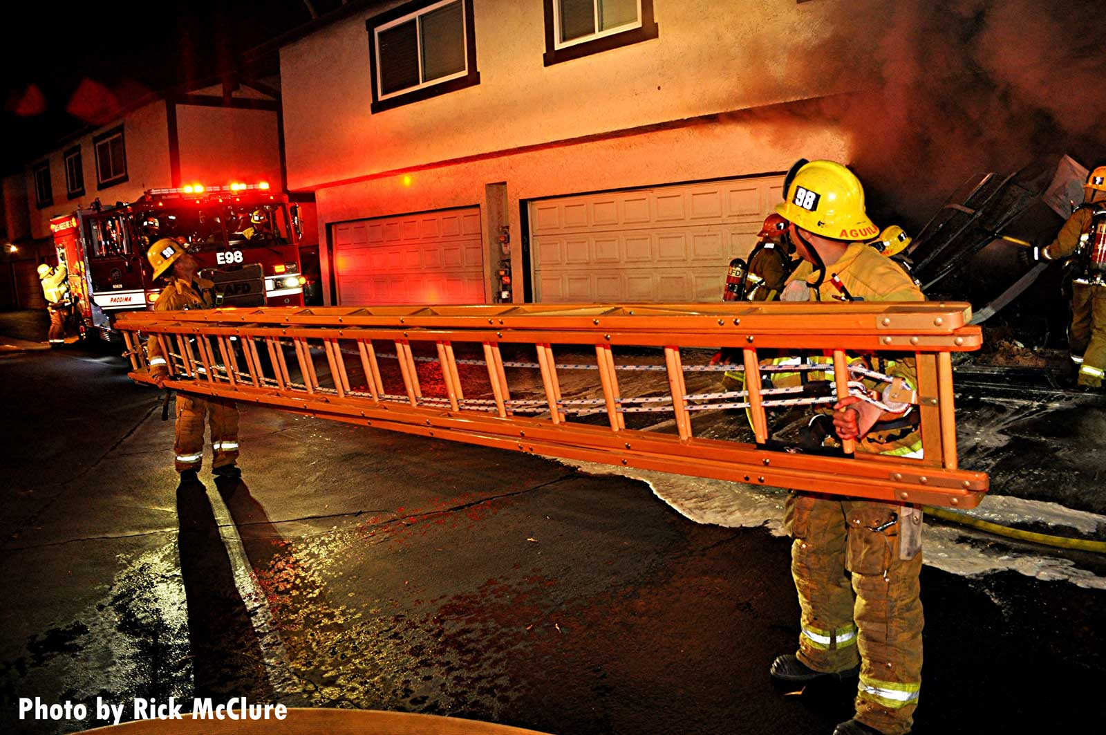 LAFD firefighters with a portable ladder