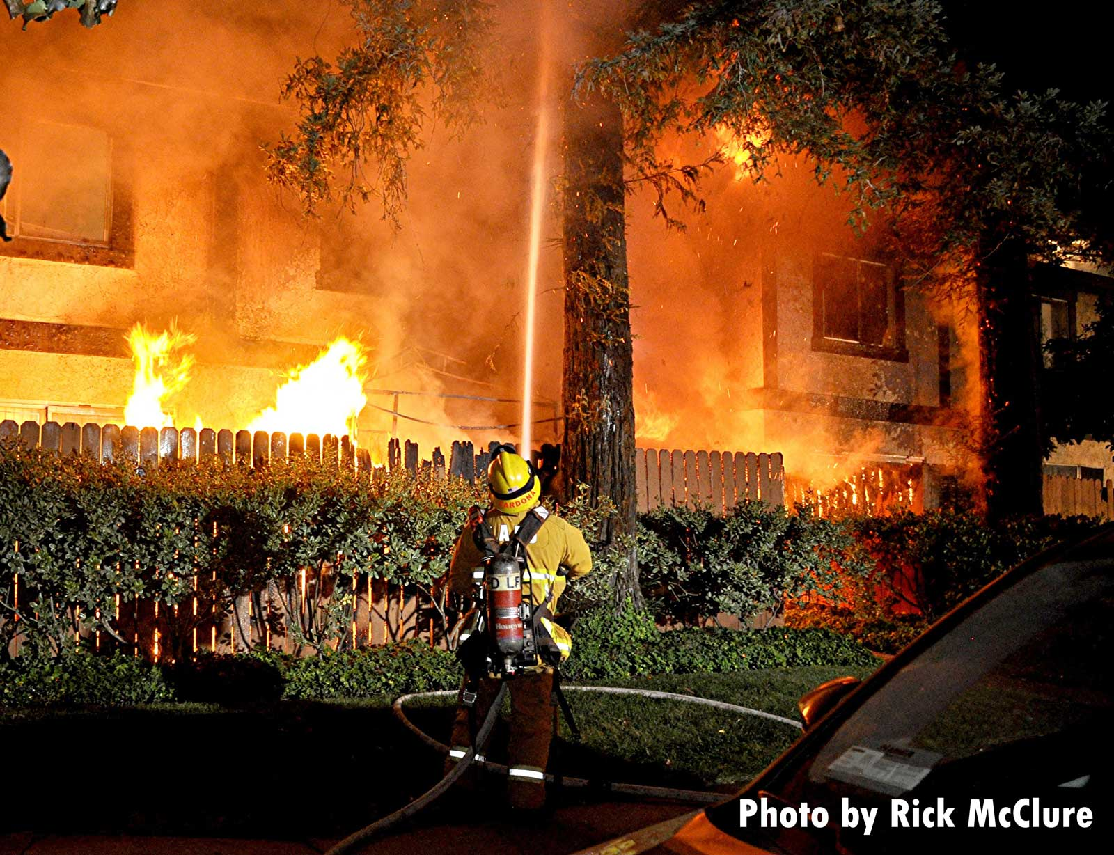 Firefighter applies an exterior hose stream