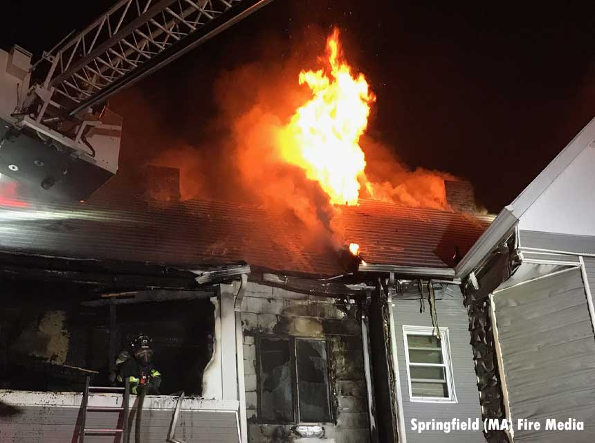 Firefighter with flames above him at Springfield fire