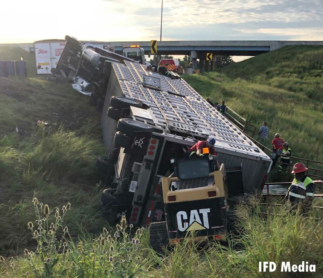 Indianapolis firefighters at scene of overturned cattle trailer