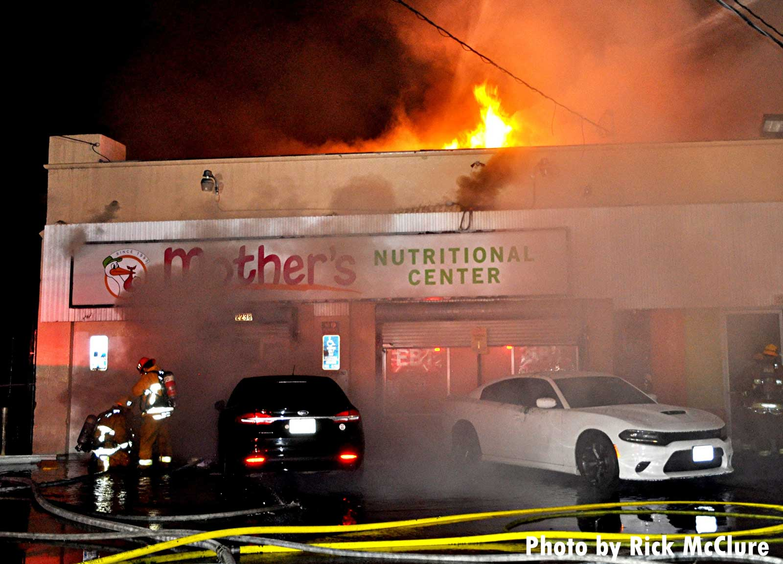 Fire rages in a large building in Los Angeles