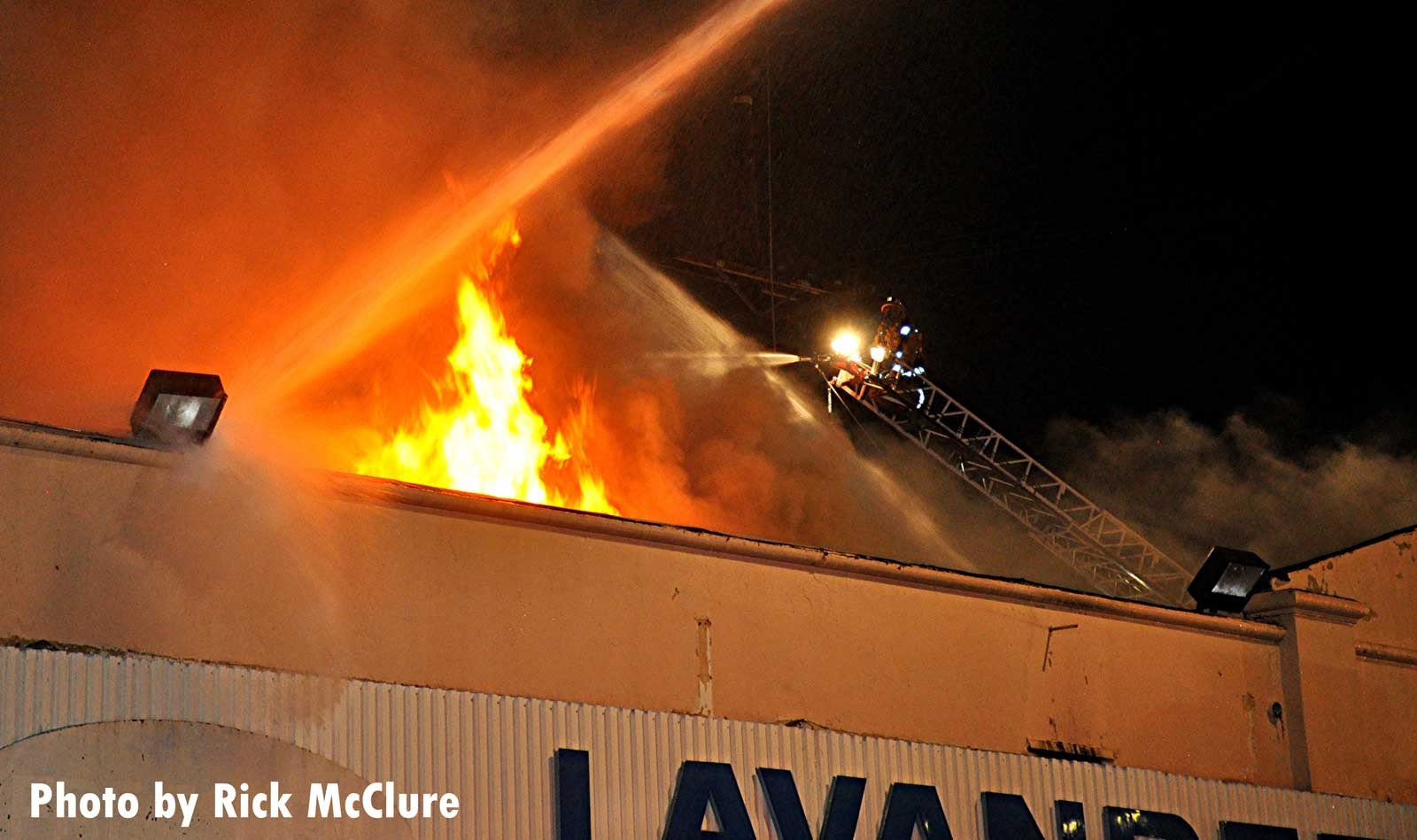 Flames shoot from the building
