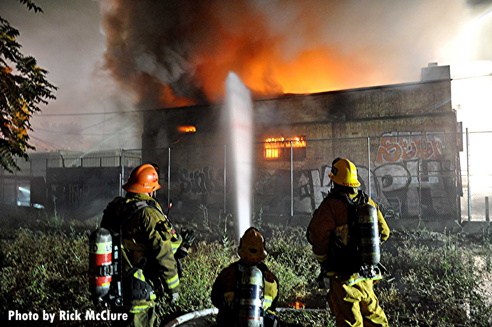 LAFD control a hoseline on the exterior of the fire
