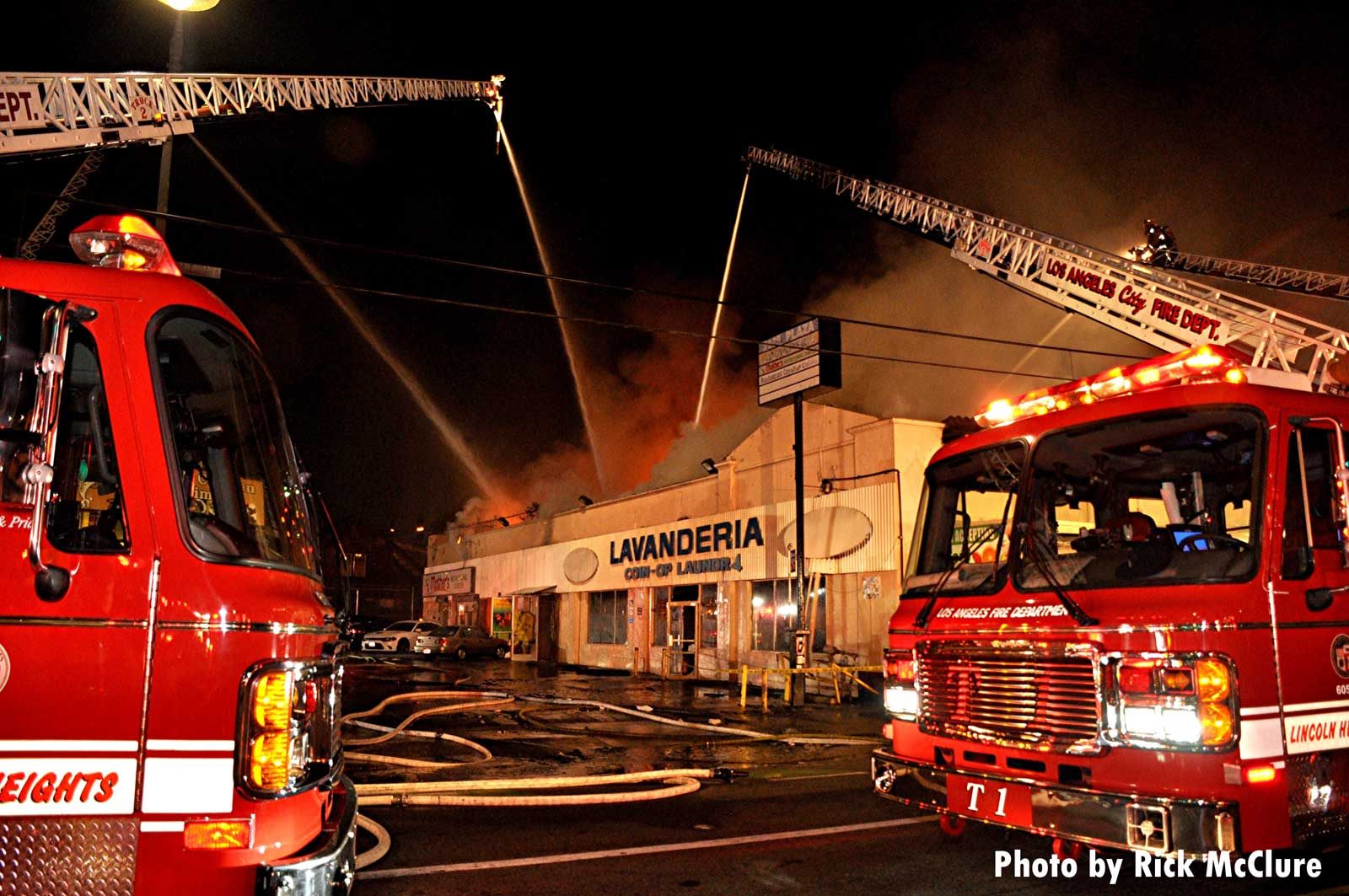 Aerial master streams put water on the fire building