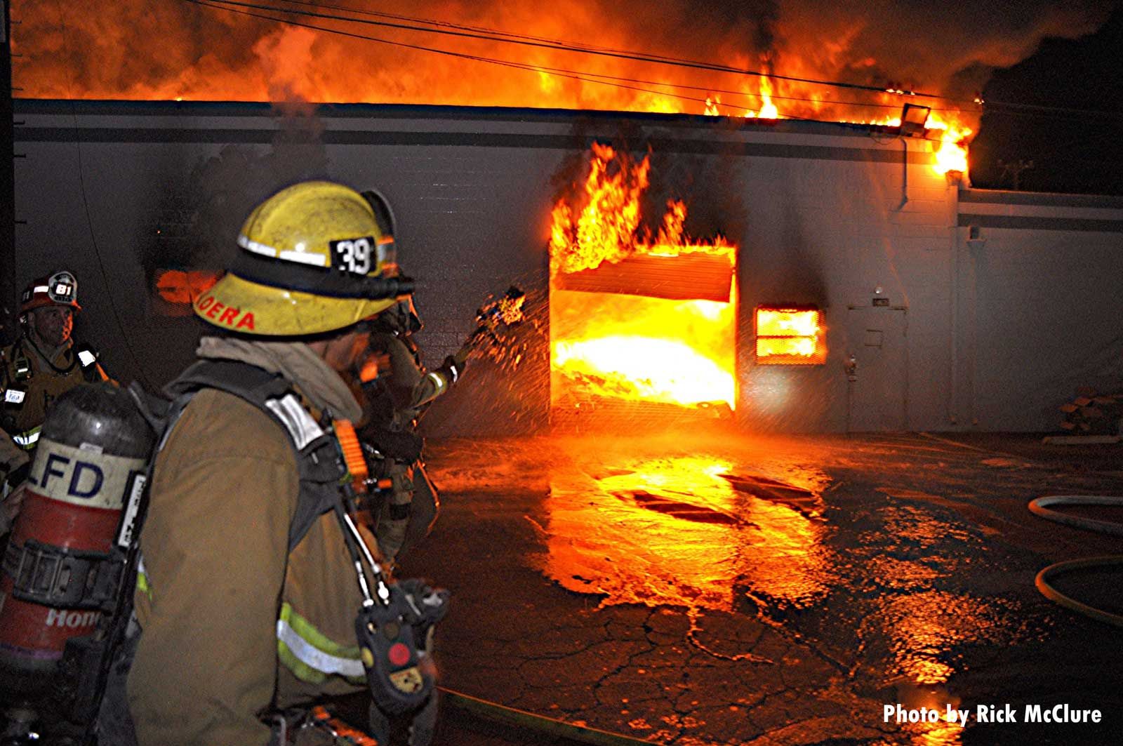Firefighter working at commercial structure in Los Angeles
