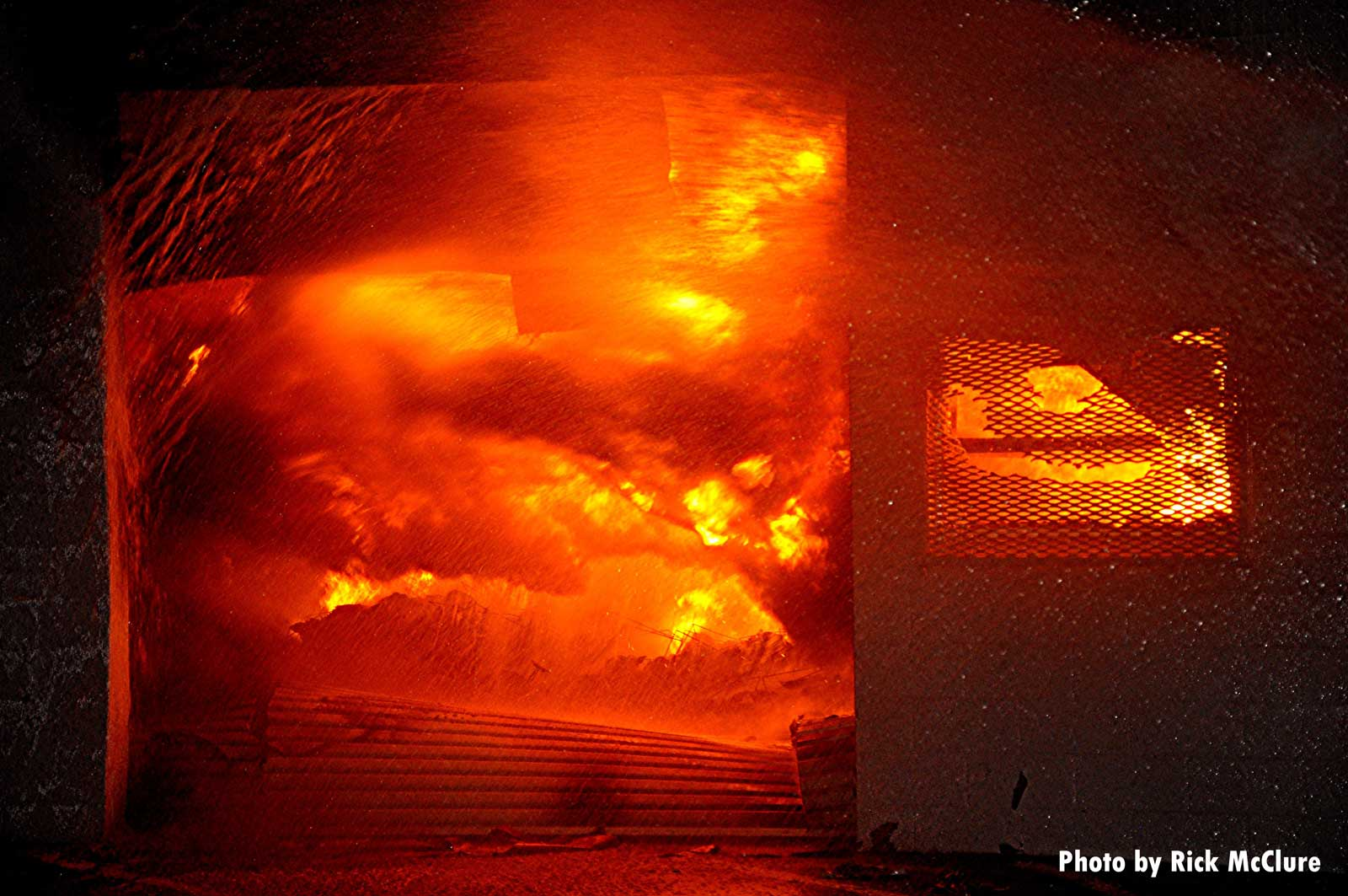 Flames consume the building