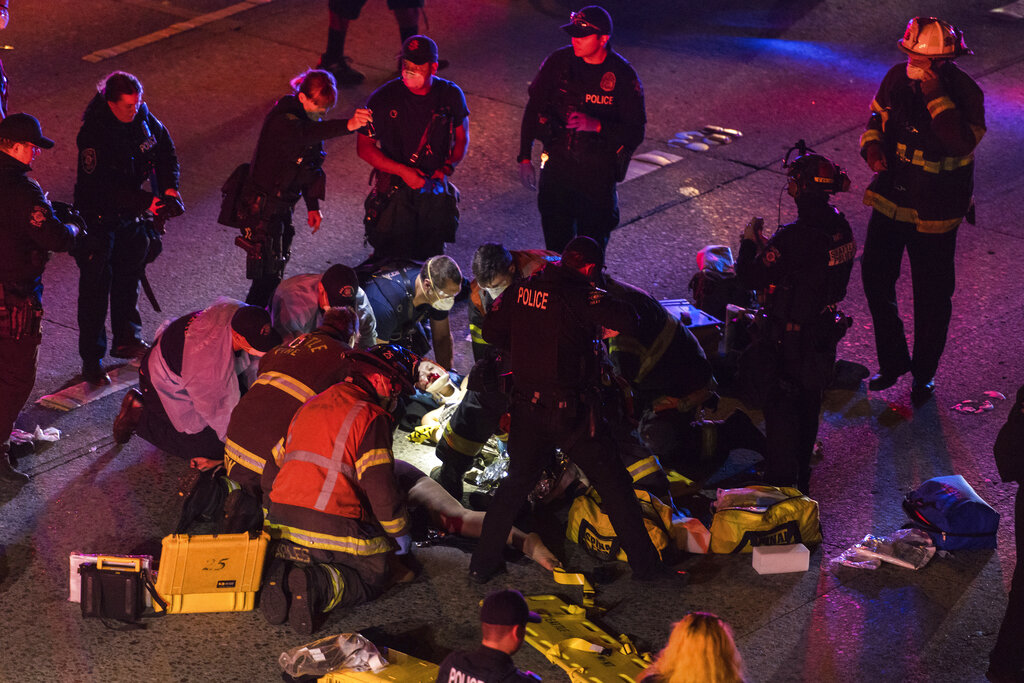First responders on scene where protester was struck by car in Seattle
