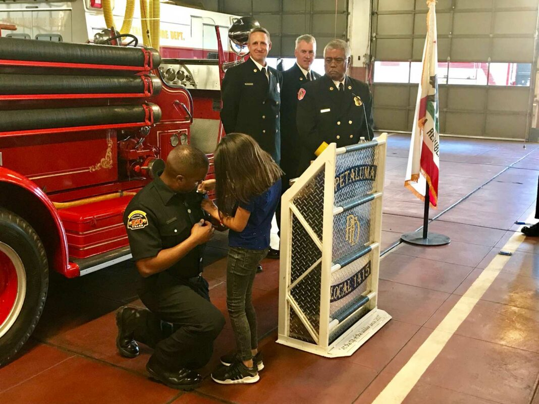 Firefighter at a recognition ceremony