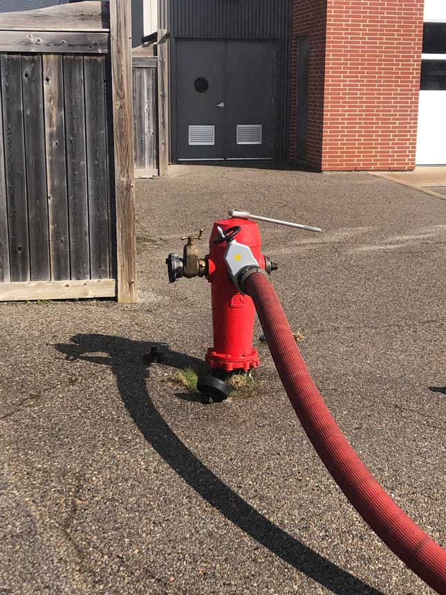 A hydrant dressed with the main supply line coming off the steamer port