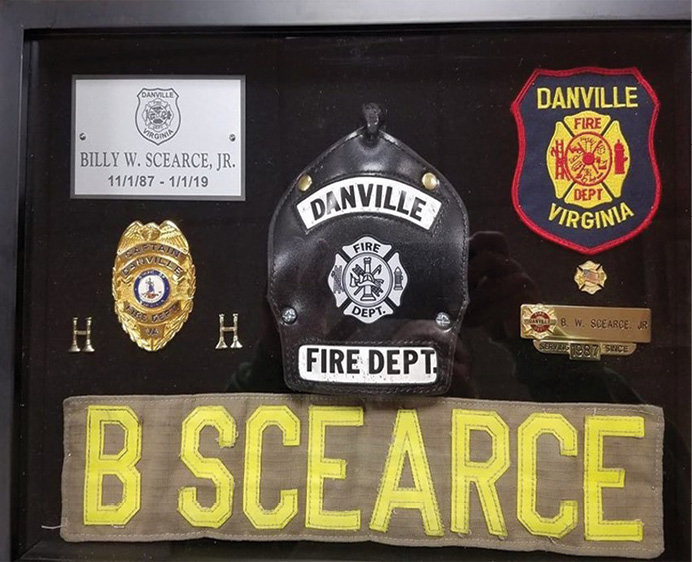 My shadowbox retirement gift containing my uniform and department-issued items presented on February 8, 2019, for 32 years of service to the Danville (VA) Fire Department.