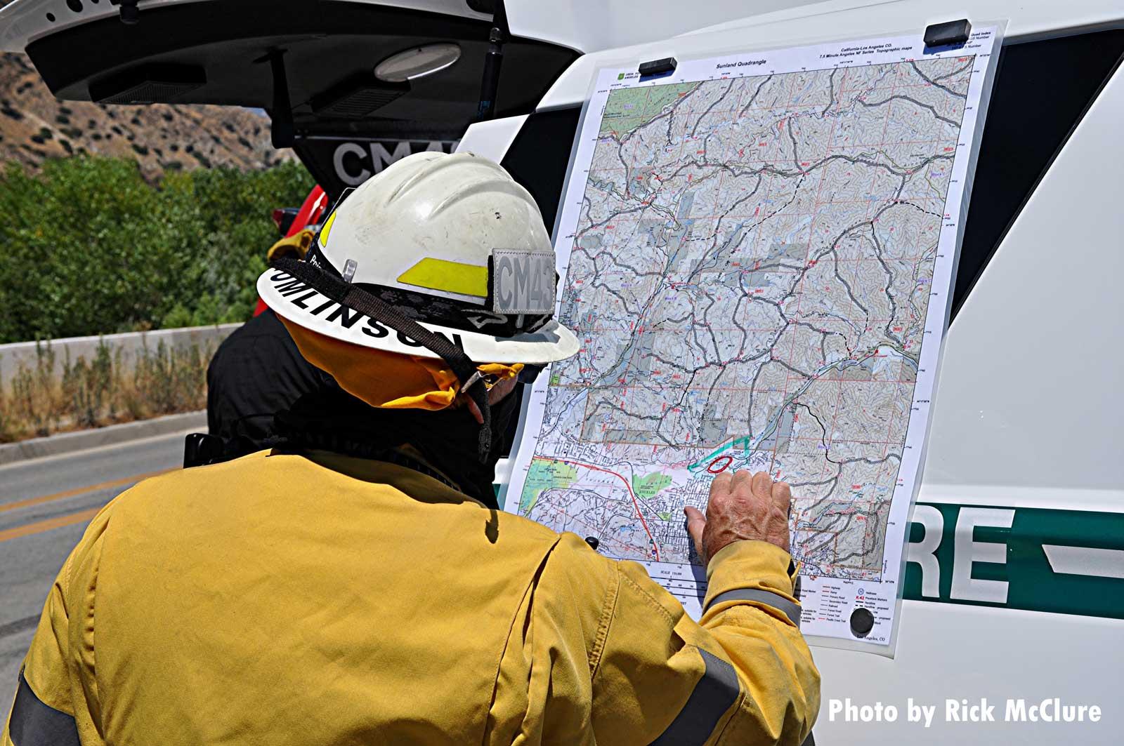 Firefighter examining map