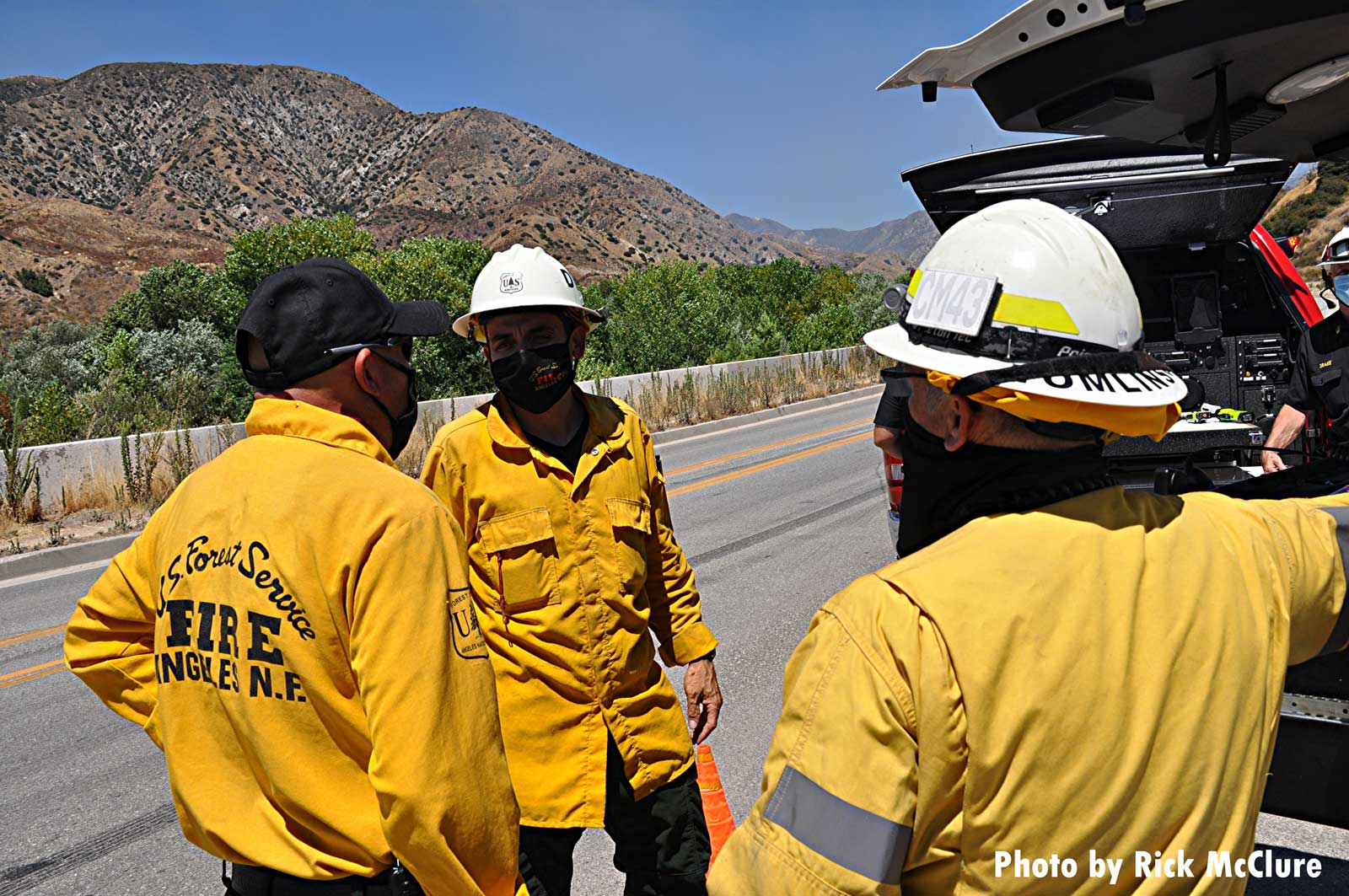 Firefighters confer at the Photos: Tujunga Fire