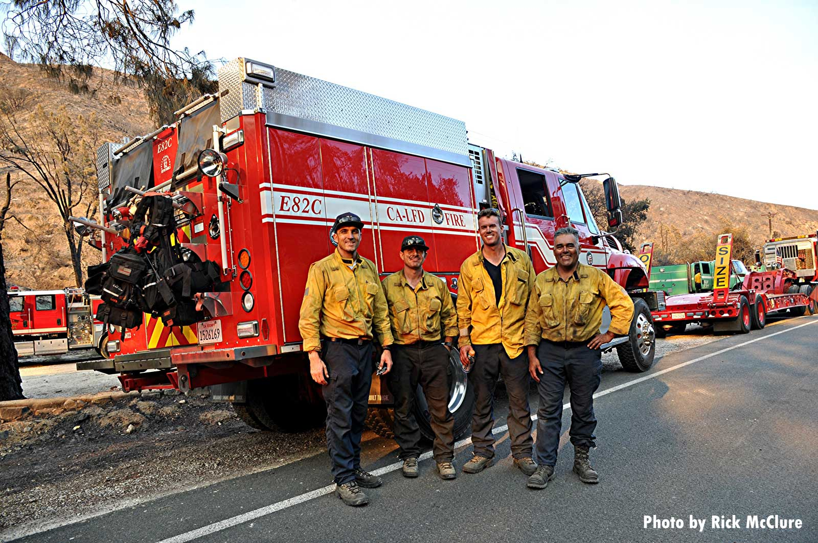 Firefighters near apparatus during wildfire fight