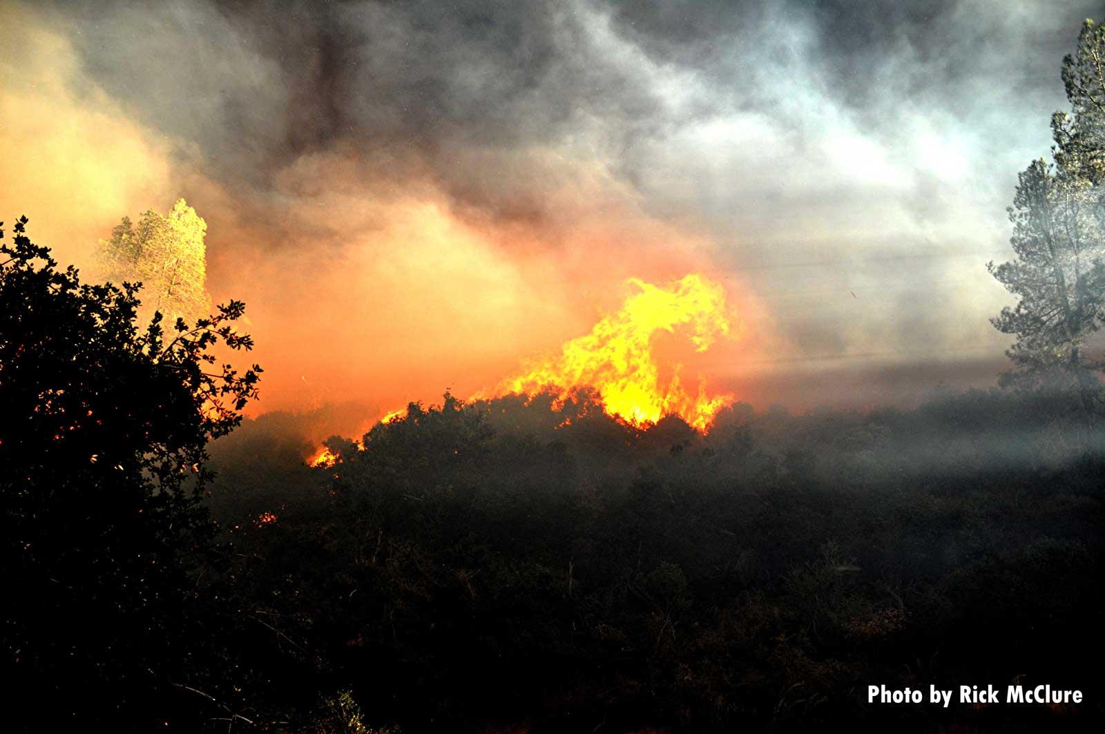 Flames rage across the landscape