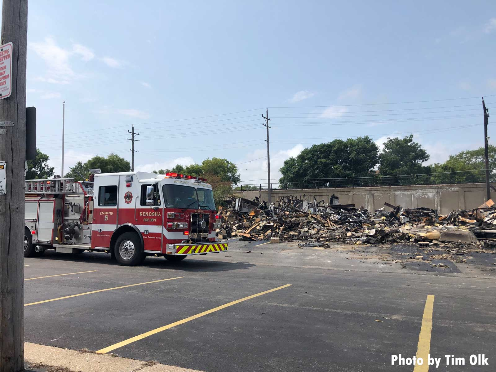 Fire apparatus in front of ruins of building in Kenosha
