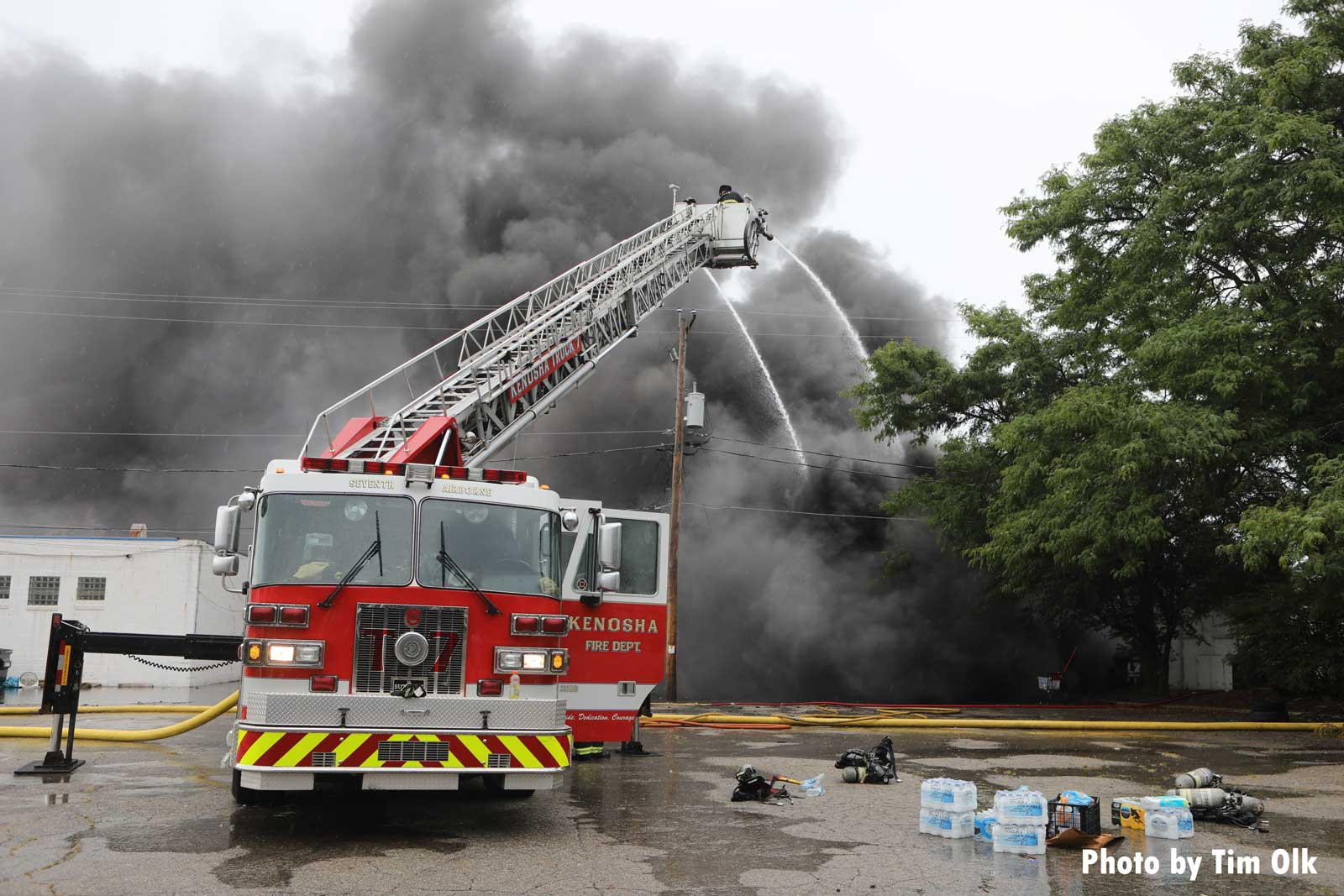 Elevated master stream use as smoke rises from structure