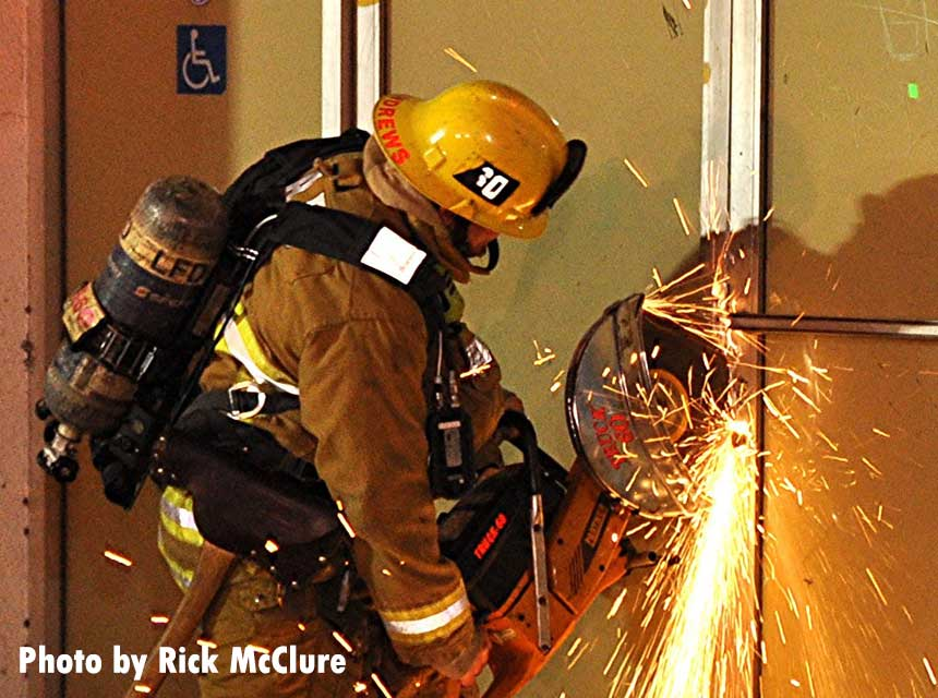 LAFD firefighter using a power saw