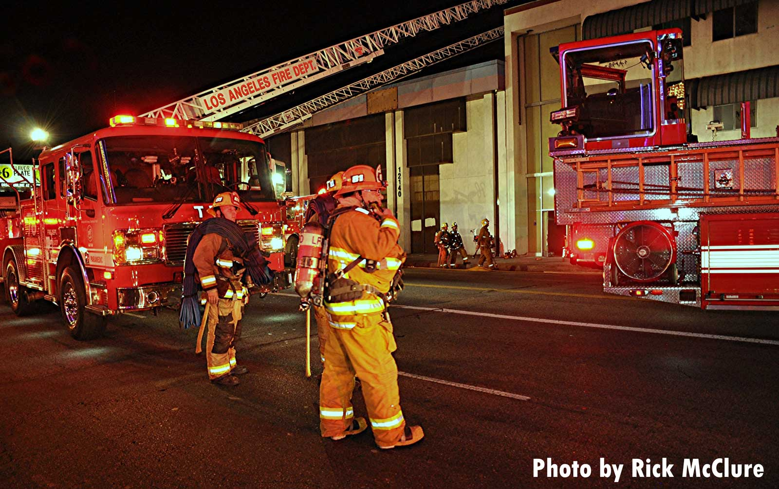LAFD fire trucks and firefighters at the fire scene