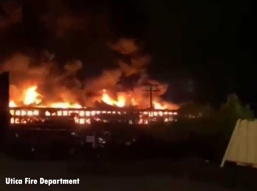 Flames shoot from abandoned mall in Utica