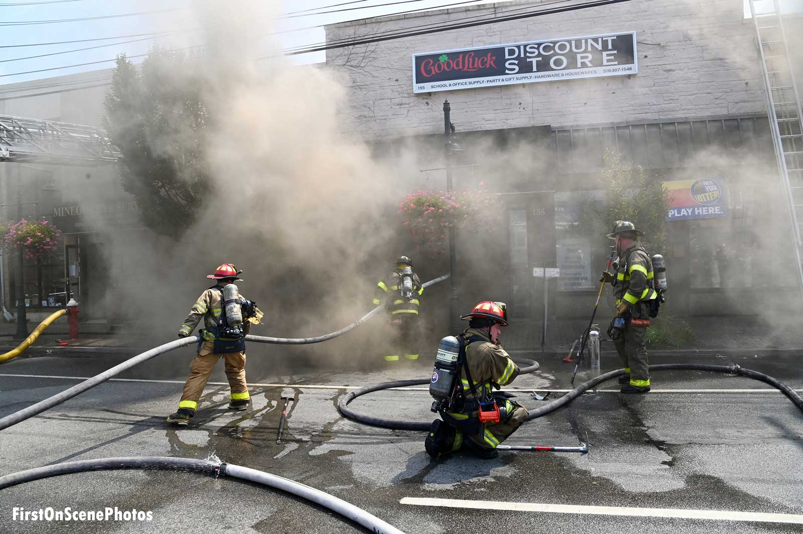 Smoke envelopes firefighters at Mineola fire
