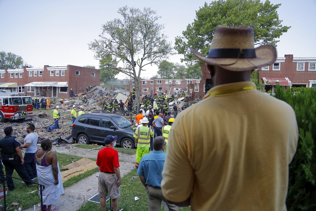 People gather outside an explosion in Baltimore