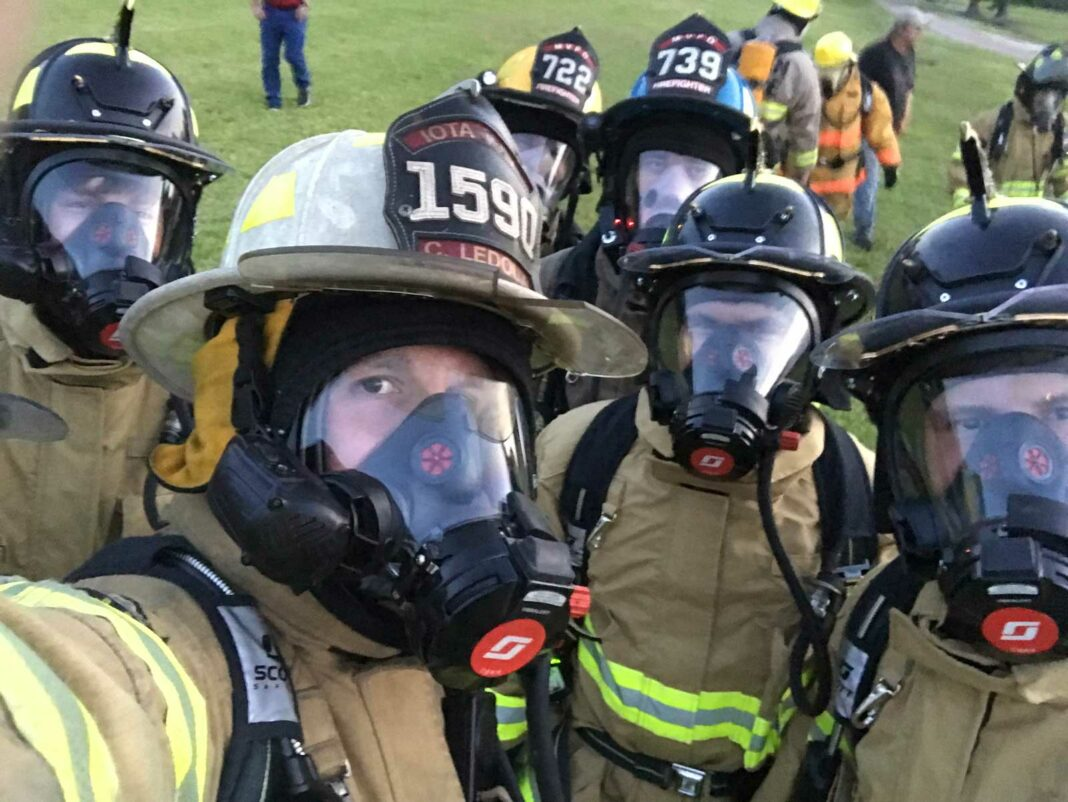 Firefighters wearing SCBA and turnout gear