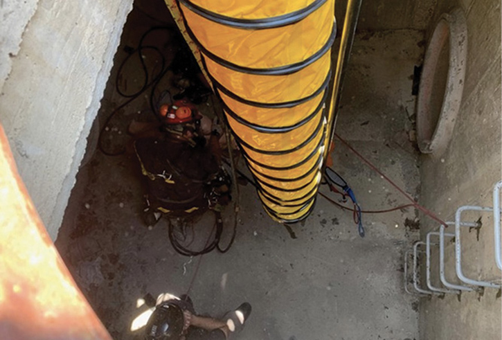 Members of MABAS Division 1 Technical Rescue Team perform ventilation of a confined space during an NFPA 1670 Confined Space Technician course delivered by Elevated Safety at the Northeastern Illinois Public Safety Training Academy in June 2020.