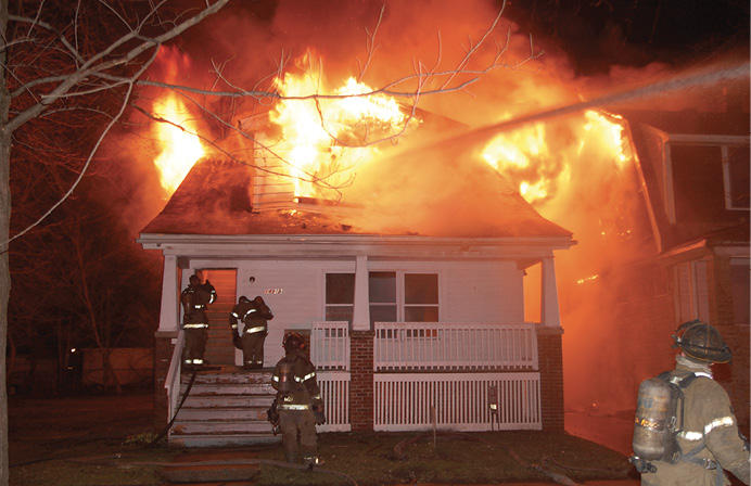 Flames erupt from a house fire