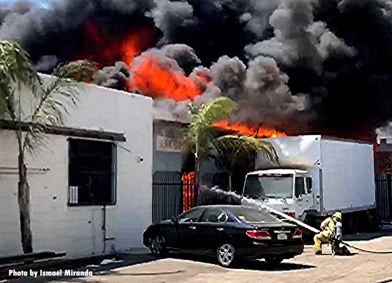 Flames shoot from a commercial building in Los Angeles