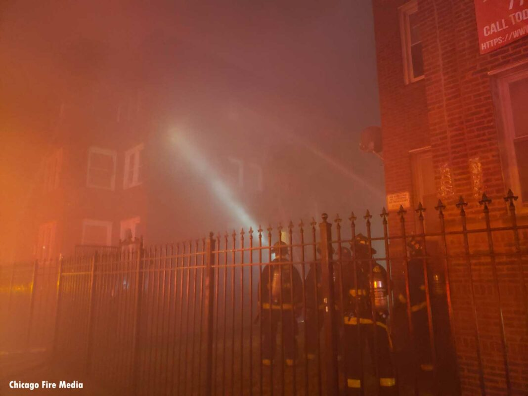 Chicago firefighters at apartment fire