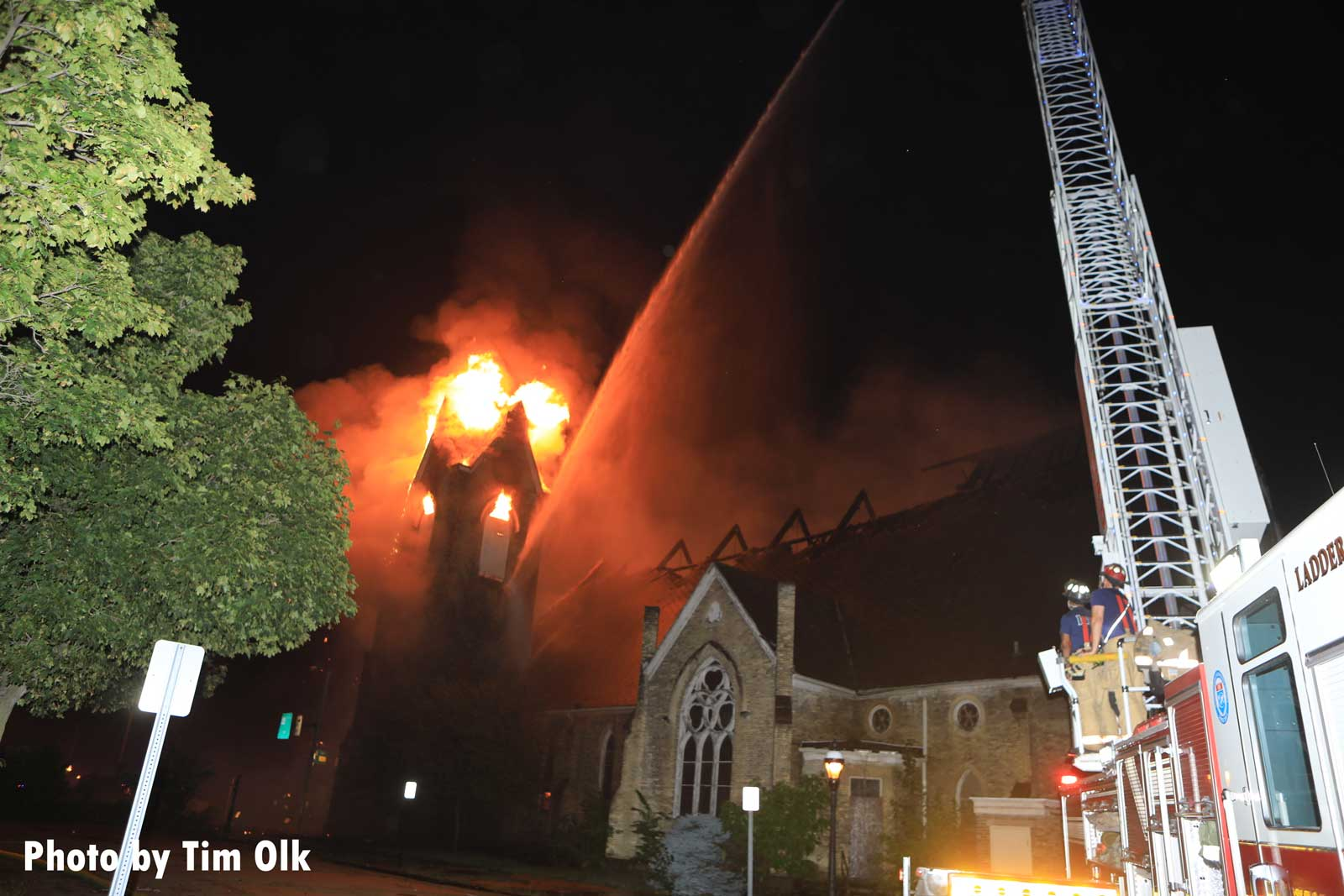 Aerial water stream trained on church fire