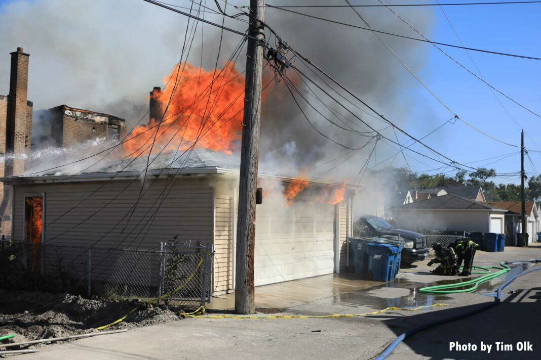 Raging fire on the roof of a garage