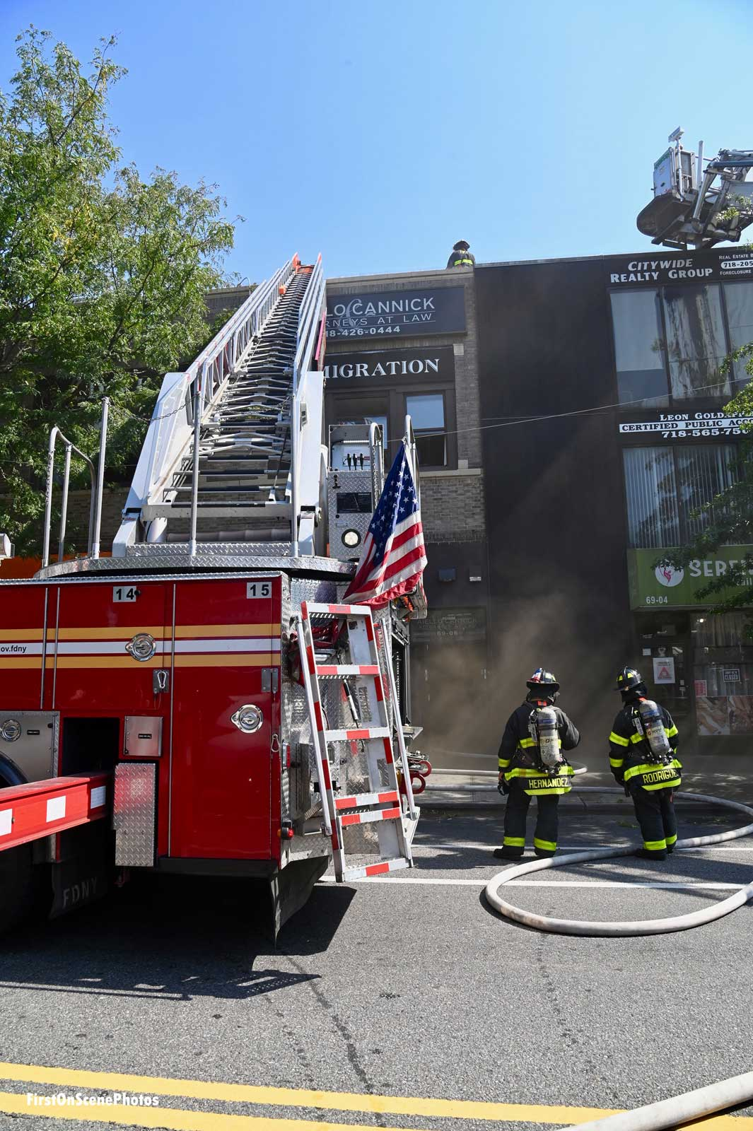 View of FDNY ladder set up to top of building