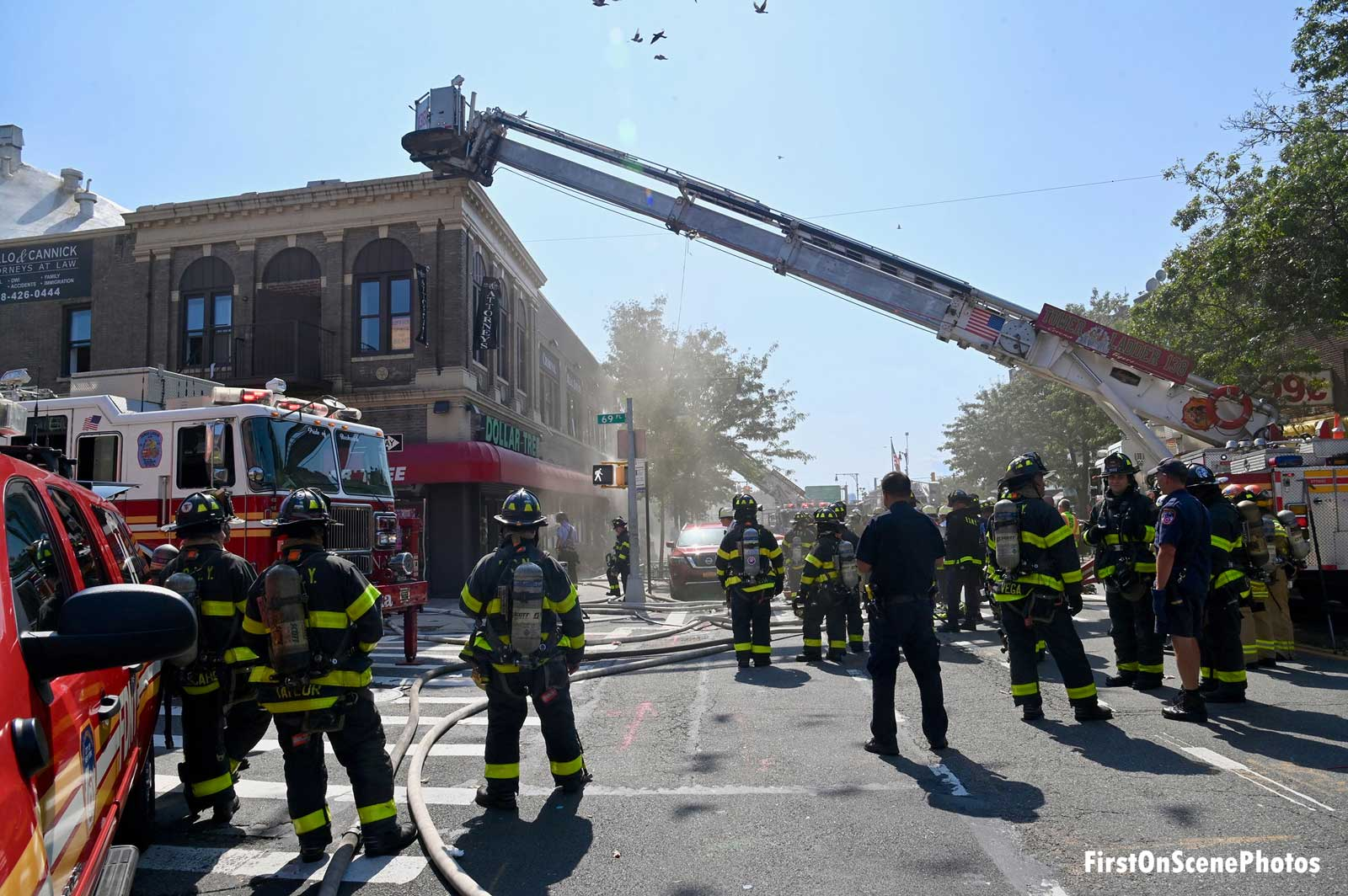 Firefighters and a tower ladder at a fire in NYC