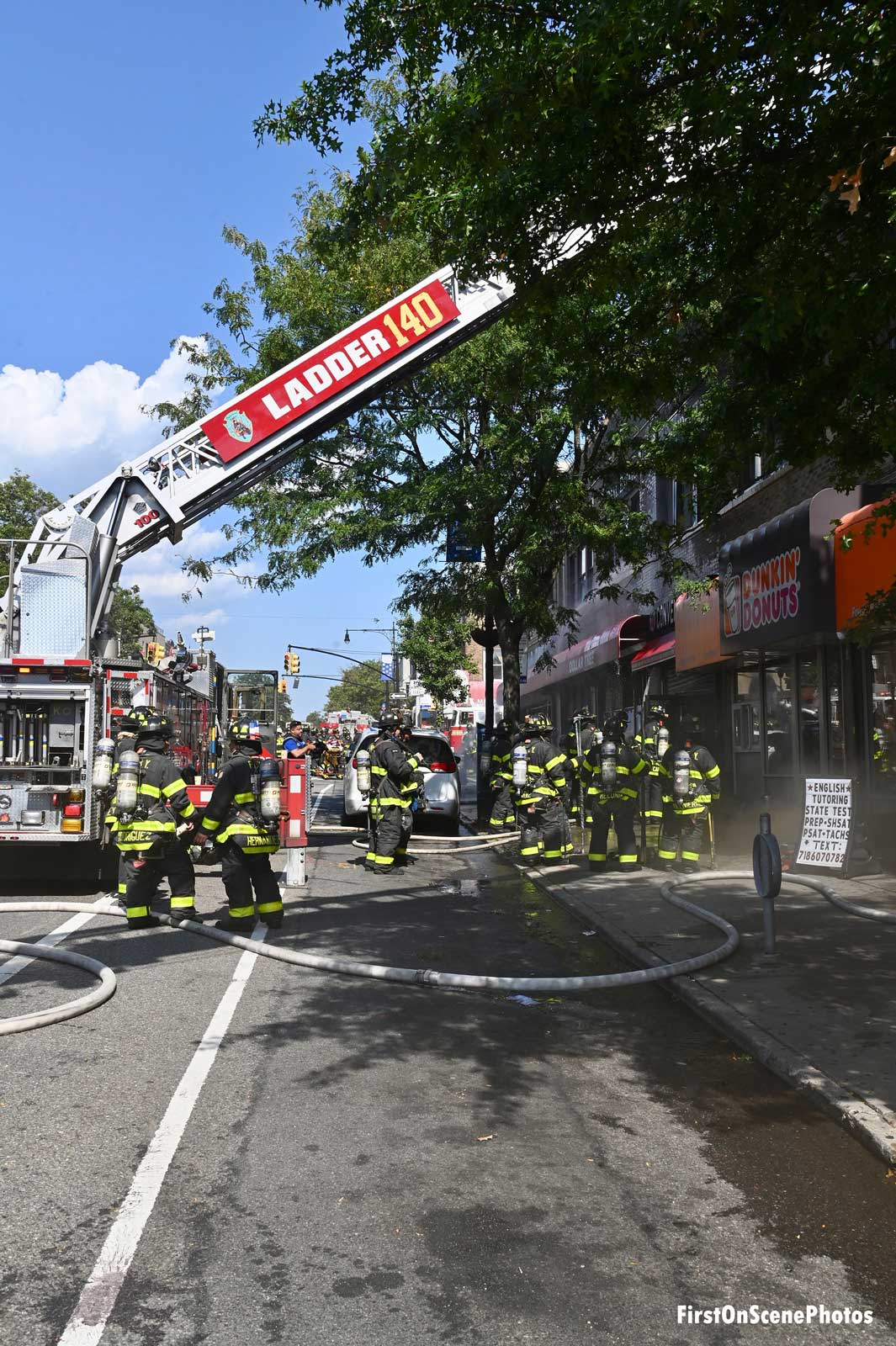 FDNY ladder truck at the scene of a fire in Queens