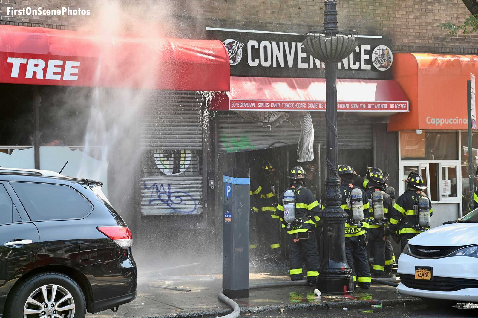 Water spray and firefighters on the fireground