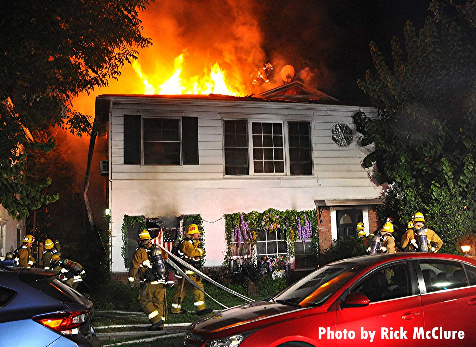 Flames rage from the home