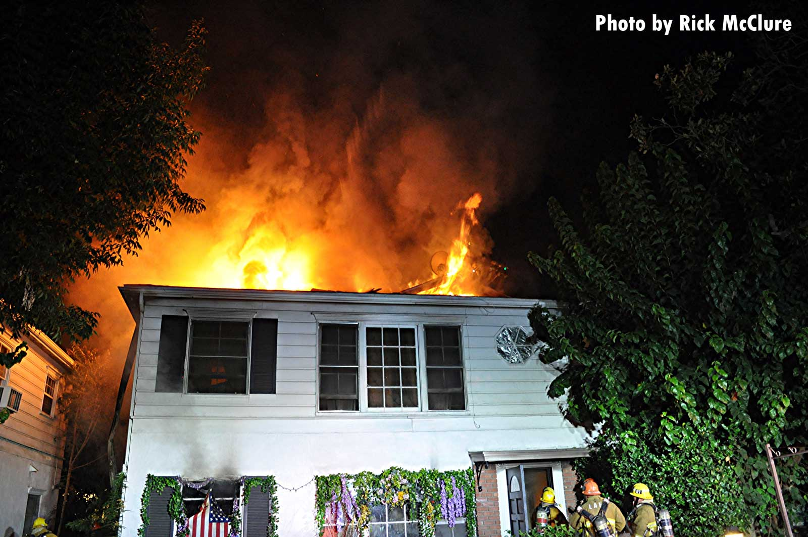 Flames rip through the roof of the residential structure