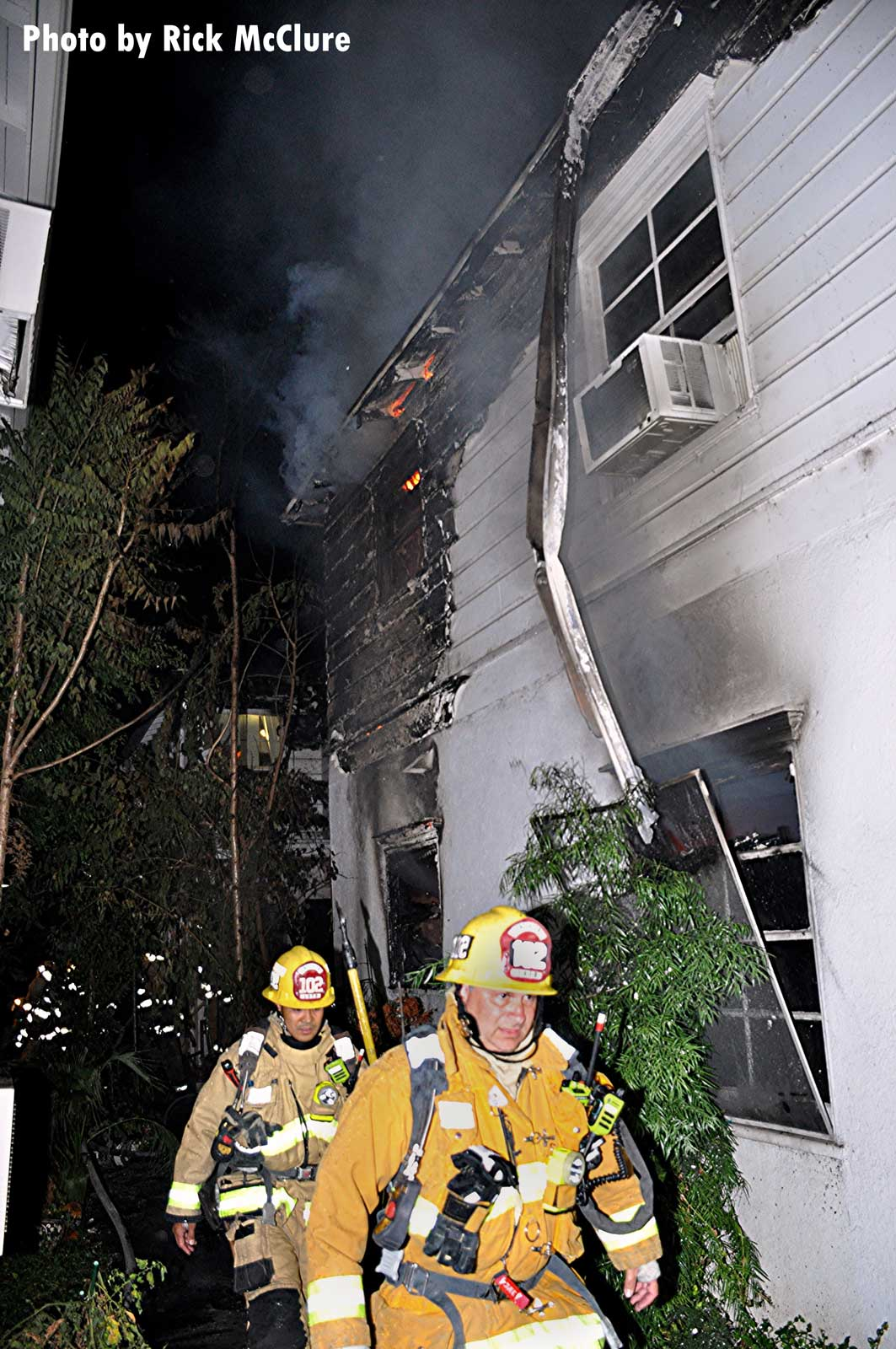 Firefighters at singed building in Los Angeles