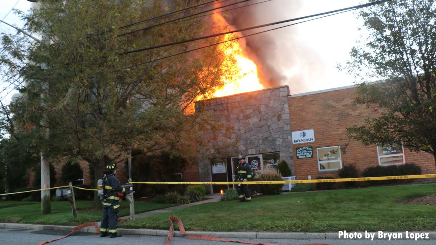 Firefighters outside commercial building fire