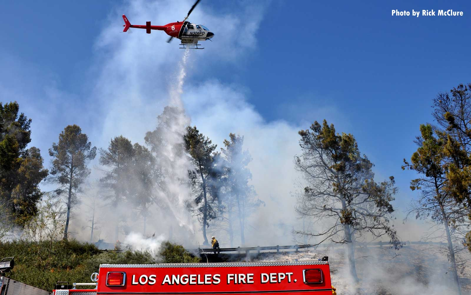Helicopter at scene of smoky California brush fire