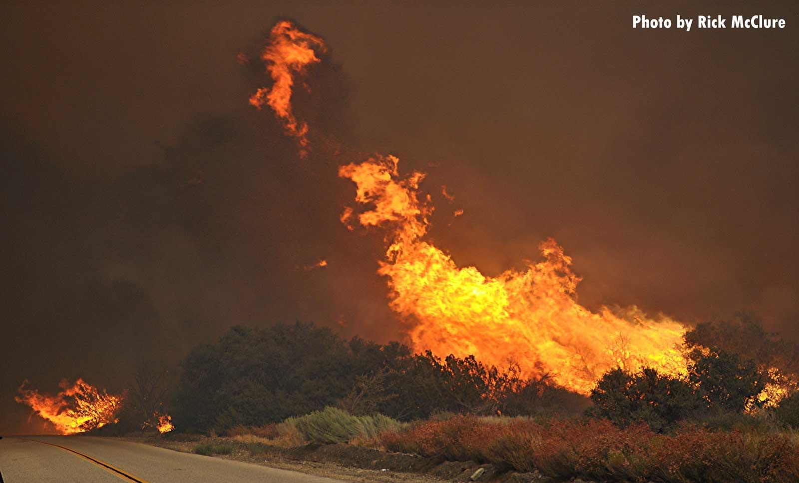 Flames burn over the landscape